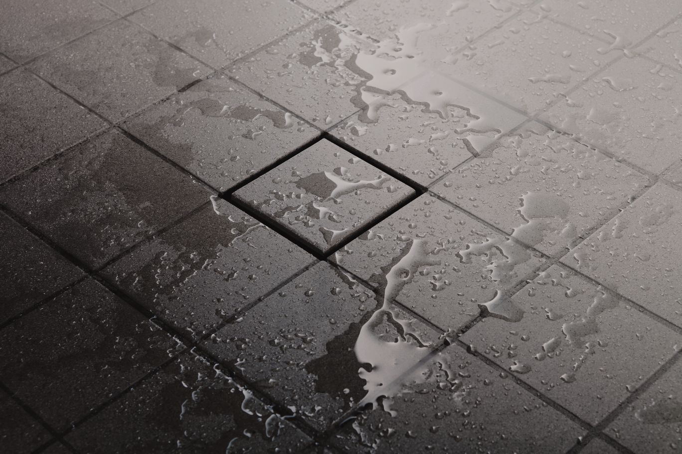 Image of invisible drain added as part of a custom shower installation by Wilkerson Floors.
